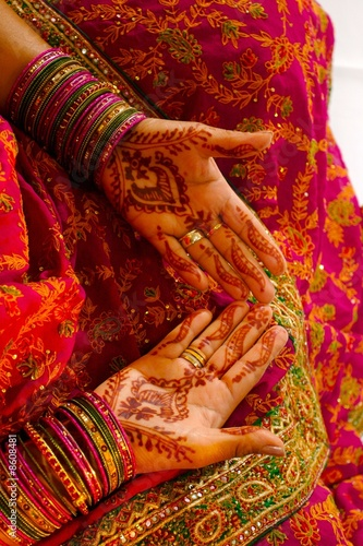 Indian wedding bride getting henna applied Poster