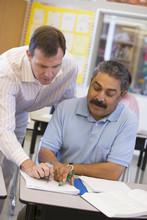Teacher Assisting Mature Stude...