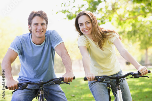 Canvas Prints Cycling Couple on bikes outdoors smiling