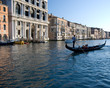 Gondolier in the Grand Canal with wo passengers
