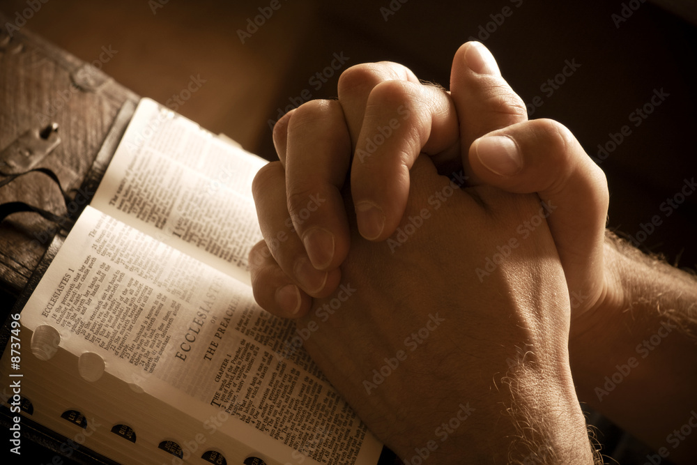 Fototapety, obrazy: Praying hands on an open bible