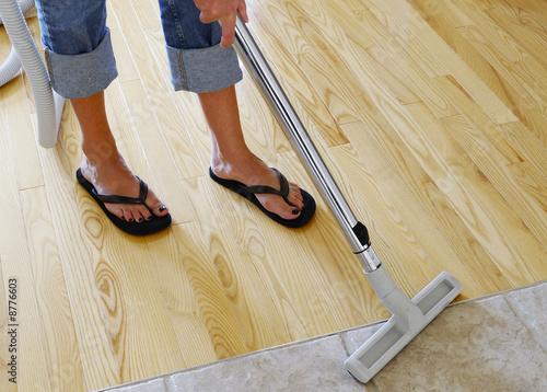 Vacuuming Wood Floor Buy This Stock Photo And Explore Similar