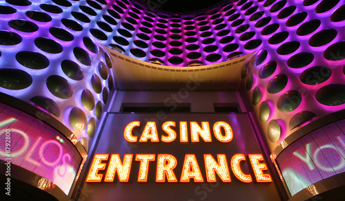 Tuinposter Las Vegas Casino entrance sign in lights at the Las Vegas Strip