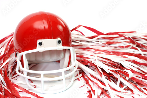Red football helmet and pom poms isolated on white