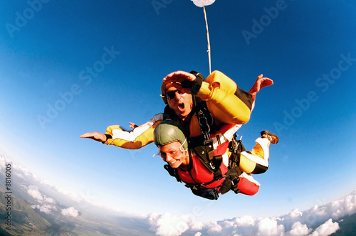Fotografie, Obraz  Tandem skydiver in action parachuting