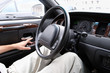 driver siting in a car and steering wheel