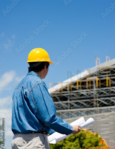 Poster Industrial geb. A construction worker or foreman at a construction site