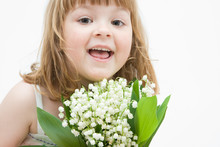Little, Pretty Girl Holding Bunch Of Lilies Of The Valley