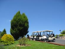 Empty Golf Carts At A Golf Club Below Beautiful Blue Sky