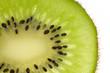 Close up of a kiwi slice over white