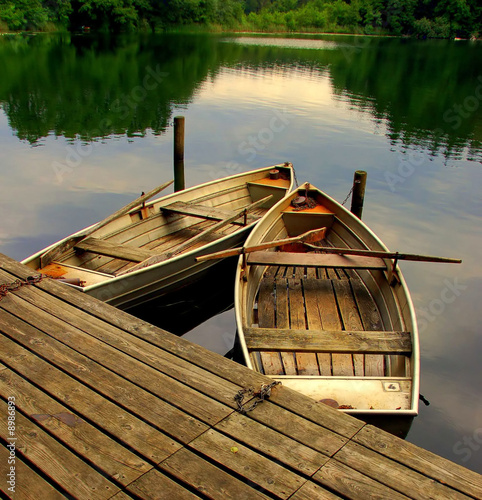 Fotografia  Two old rowing boats on a lake