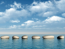 A Row Of Stones In Water. A Pe...