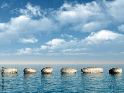 Pinturas sobre lienzo  A row of stones in water. A pebble on a background of the sky
