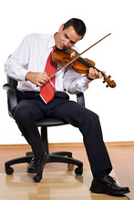 Businessman Play The Violin-is...