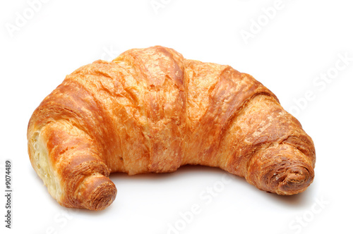 Foto Fresh delicious croissant isolated over white background