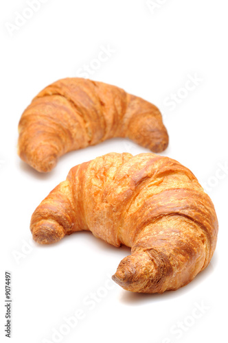 Fotografie, Obraz  Two fresh croissant isolated over white background