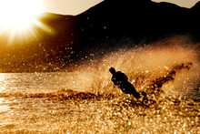 A Male Waterskiing In The Even...