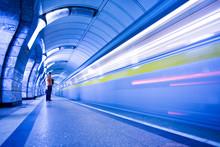 Train On Platform In Subway An...