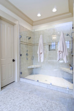 Minimalist Bathroom With Large Glass And Tile Shower