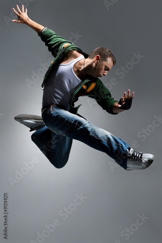 cool looking dancer makes a difficult jump