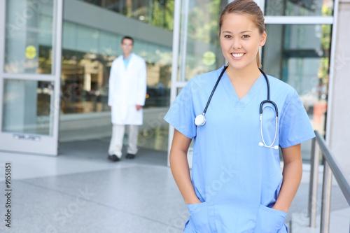 Fotografie, Obraz  A pretty woman nurse outside hospital office building