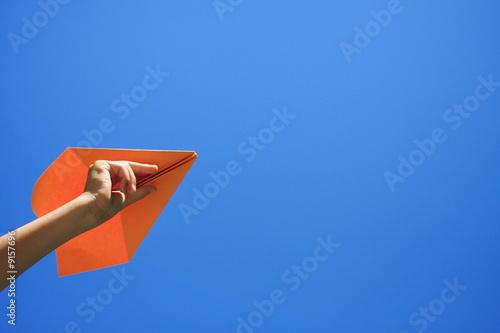 avion en papier orange Canvas Print