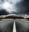 canvas print picture Motion blurred road heading to the Mountains