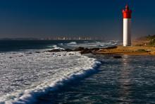 Umhlanga Lighthouse With Durban Cityscape As Background