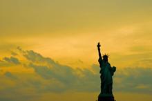 Lady Liberty On A Foggy Sunset