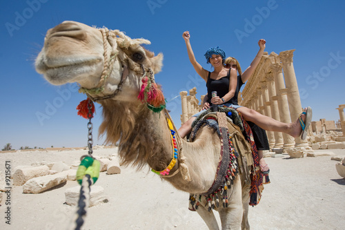 Fotografie, Obraz  two girls are ride on camel in desert