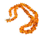 Amber Necklace On Blue Backgro...