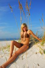 Beautiful Woman On Sand Dune At Beach