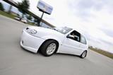 Fototapeta Miasto - Fast car moving with motion blur