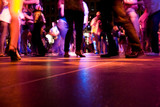 A low shot of the dance floor with people dancing