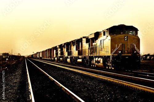 Freight train travelling through Arizona at Sunset