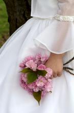 Flower Girl Holding Pink Flowers In Hand