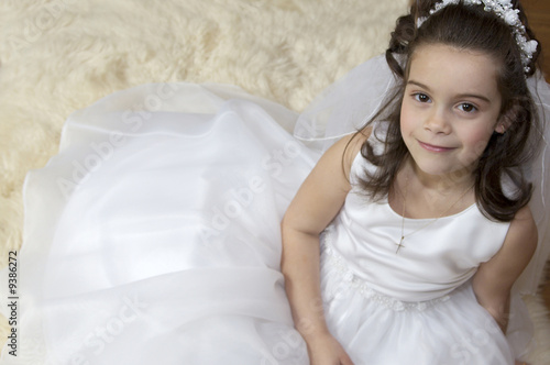 Fotografie, Obraz  Portrait of a little girl in communion dress and veil.