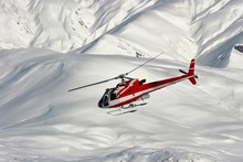 Mountain Rescue Helicopter On A Snowy Landscape