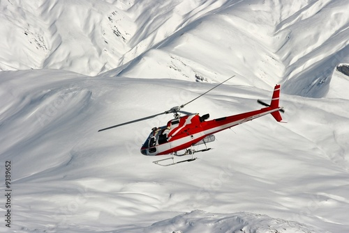 Foto op Canvas Helicopter Mountain rescue helicopter on a snowy landscape