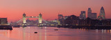 Fototapeta Londyn - Tower Bridge and city of London with deep red sunset