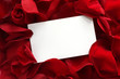 canvas print picture - Blank white gift card on a bed of red rose petals