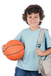 Student boy blond with a basketball over white background