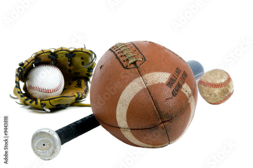 Deurstickers Retro A well used football, baseball and bat. Isolated on white.