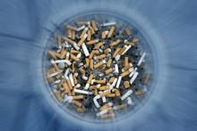 Close Up Shot Of Cigarettes Bu...