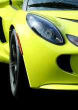 A Isolated Yellow Sports Car On Black