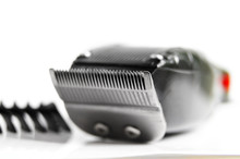 Closeup Of Hair Clippers And Guide, On White