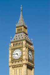Fototapeta na wymiar Detail of clock face of Big Ben, London against blue sky