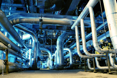 Staande foto Industrial geb. Pipes, tubes, machinery and steam turbine at a power plant