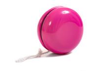 A Child's Pink Yo-yo On A White Background With Copy Space