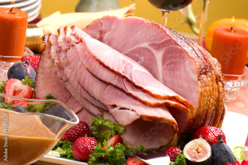 Fototapeta Holiday table setting with delicious whole baked sliced ham obraz